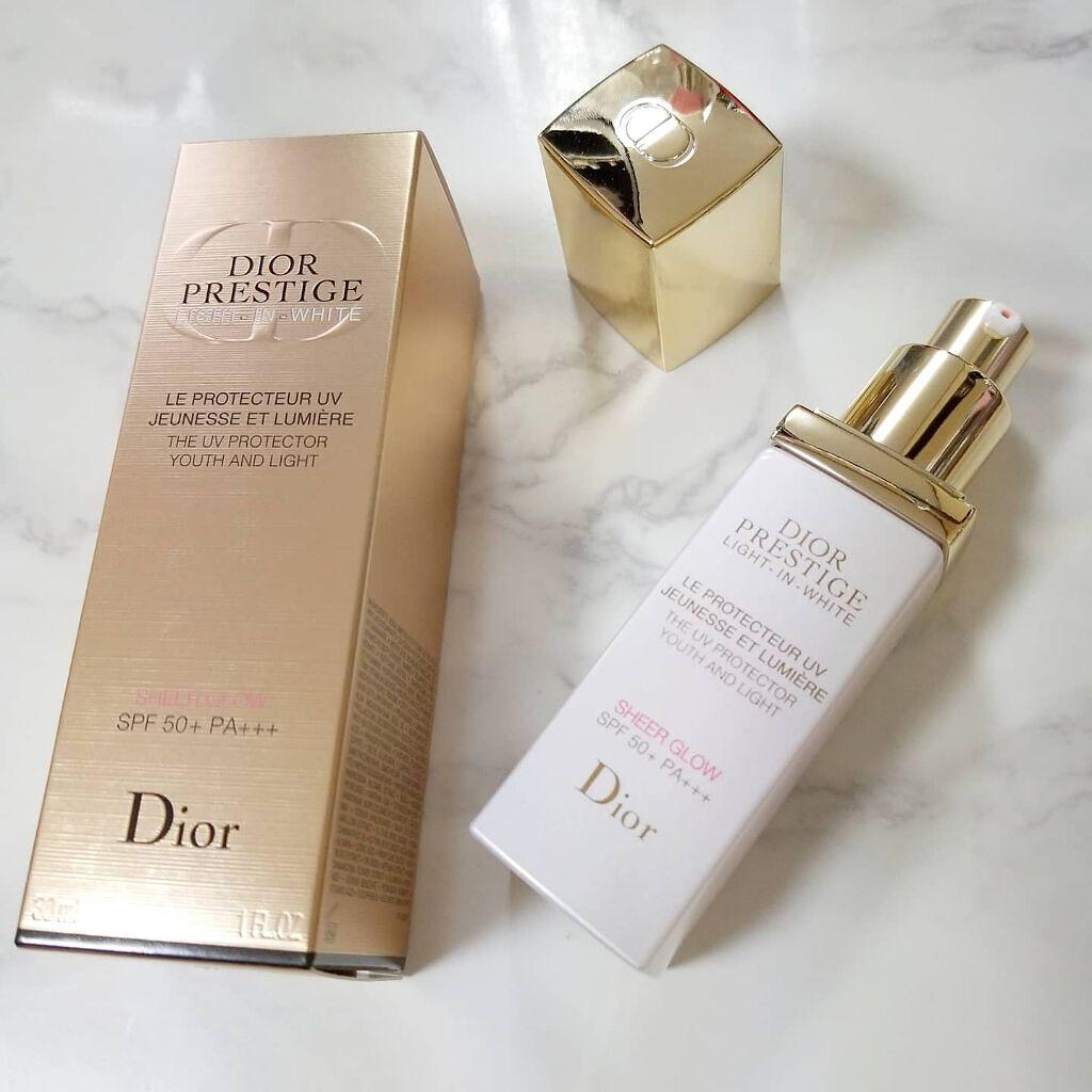 Dior 玫瑰花蜜純白煥光全效防曬乳液實品圖